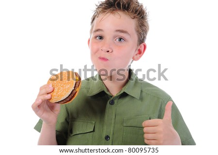 Little boy eating a hamburger. isolated on a white background