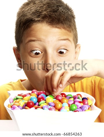 Little boy eating candy on white background. Little boy eating chicle. - stock photo
