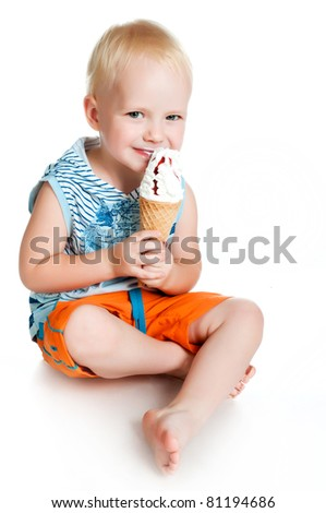 little boy eating ice cream on a white background - stock photo