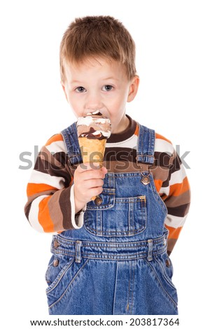 Little boy eating the cone of ice cream, isolated on white - stock photo