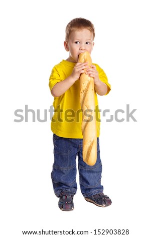 Little boy eating the french baguette, isolated on white - stock photo