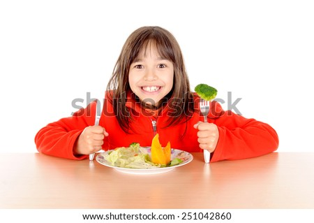 little boy eating vegetables isolated in white background - stock photo