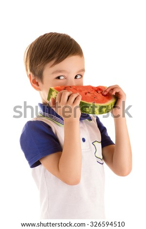little boy eating watermelon isolated on white