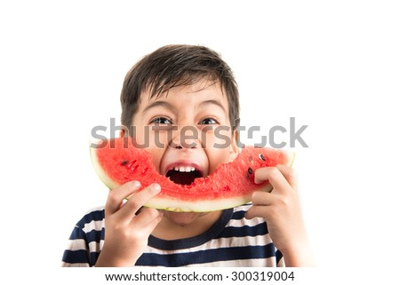 Little boy eating watermelon on white background - stock photo