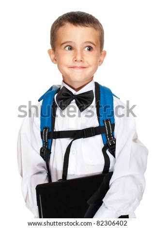 Little boy elementary student with laptop, backpack and bowtie isolated on white
