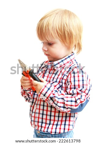 Little boy examines pliers.Childhood education development in the Montessori school concept. Isolated on white background. - stock photo
