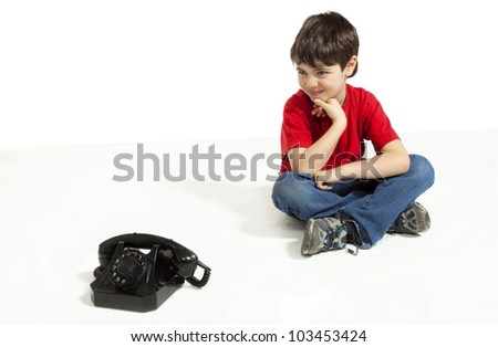 little boy expecting a phone call - stock photo