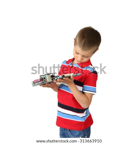 Little boy explores computer cir?uit board isolated on square white background - stock photo