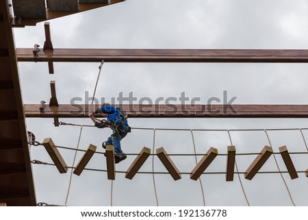 Little boy finishing an obstacle course - stock photo