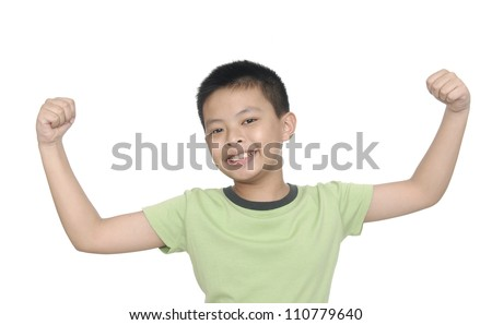 little boy flexing biceps isolated against white background - stock photo
