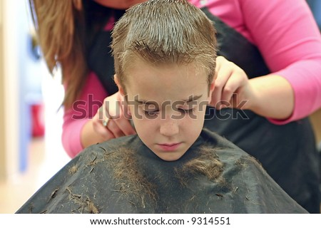 Little Boy Getting a Hair Cut - stock photo
