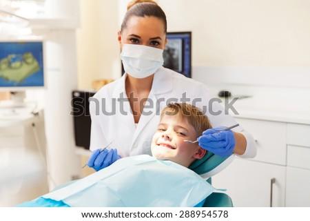 little boy getting dental checkup in dentist office - stock photo