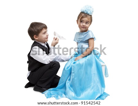 Little boy give a glass slipper to little girl - stock photo