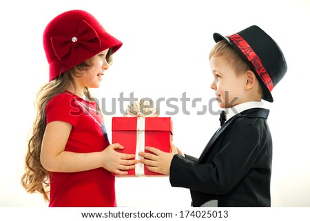 Little boy giving girl gift. Present for a birthday, valentine's day, birthday or other holiday. Isolated on white background