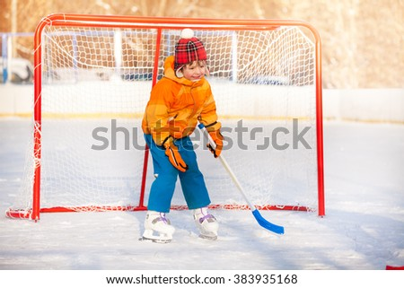 Little boy goalkeeper play ice hockey  - stock photo