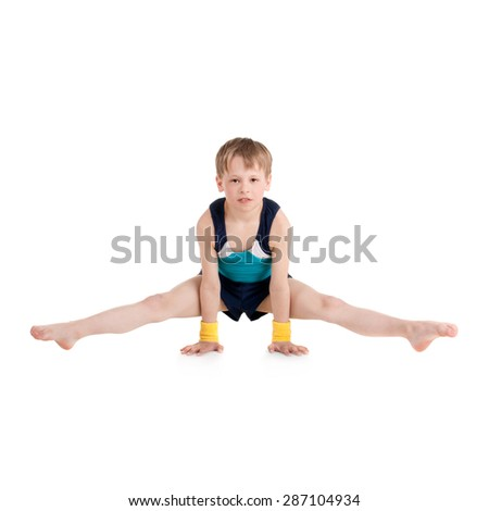 little boy gymnast doing exercises - stock photo