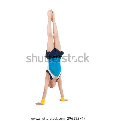 little boy gymnast standing head over feet
