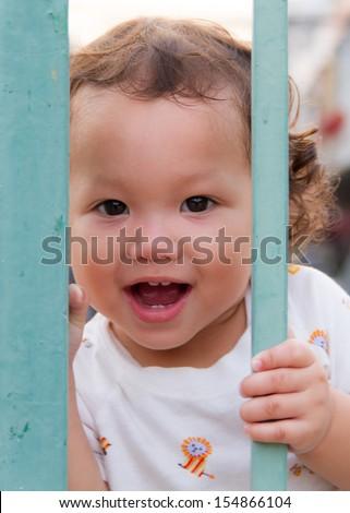 Little boy handle the bars - stock photo