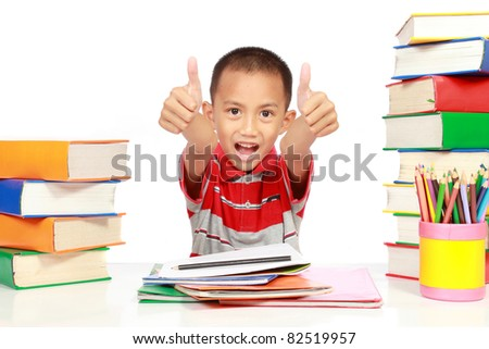 little boy happy studying and showing his two thumbs up - stock photo