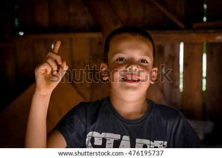 Little boy has an idea pointing by finger