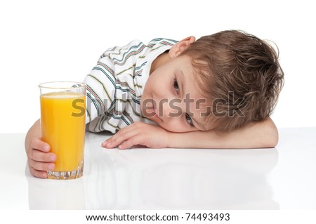 Little boy having a glass of refreshing oranges juice - isolated on white