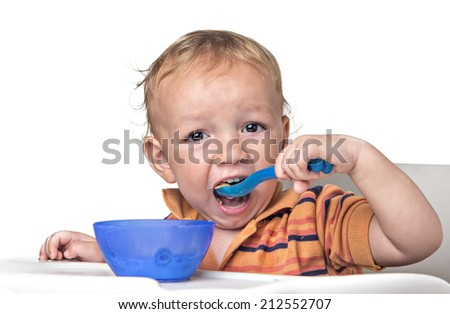 little boy having fun eating his cereal