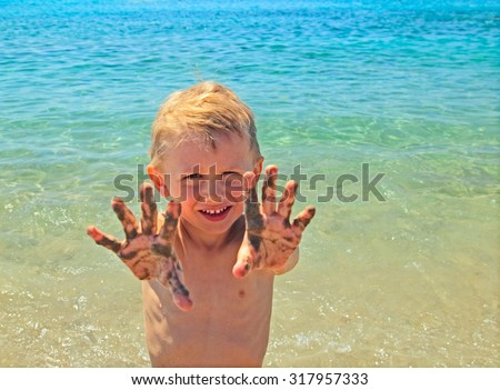 little boy having fun on beach