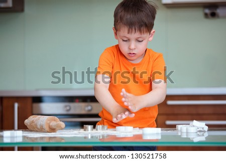 Little boy helping with baking cookies