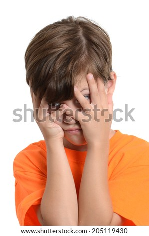 little boy hiding face with hands isolated white background - stock photo