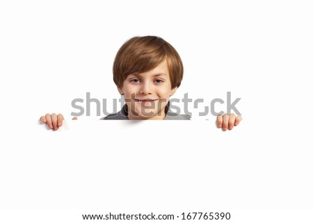Little boy holding a blank white billboard