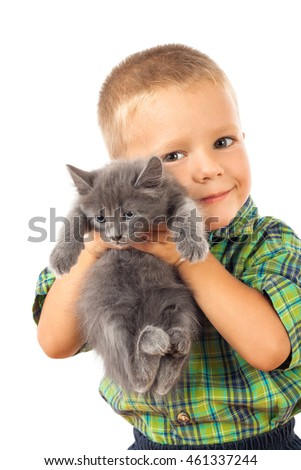 Little boy holding a gray kitten, isolated on white