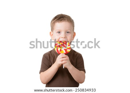 little boy holding a lollipop on a white background