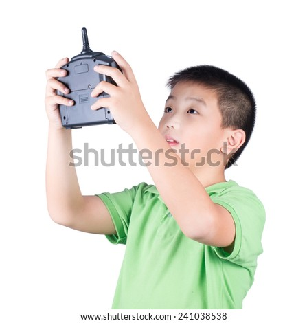 Little boy holding a radio remote control (controlling handset) for helicopter , drone or plane Isolated on white background - stock photo