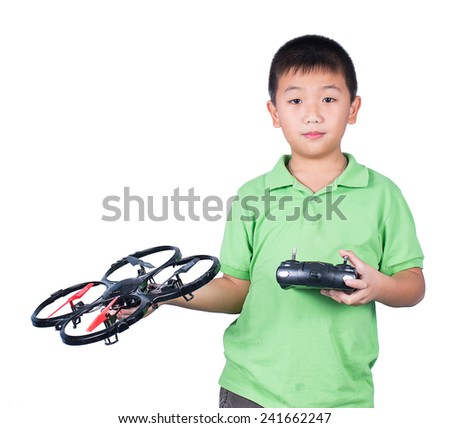 Little boy holding a radio remote control (controlling handset) for helicopter , drone or plane Isolated on white background