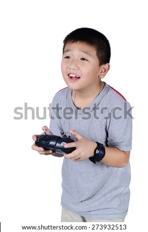 Little boy holding a radio remote control (controlling handset) for helicopter , drone or plane Isolated on white background.