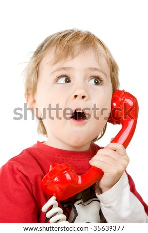 Little boy holding a red telephone receiver.  Isolated against a white background. - stock photo