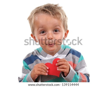 Little boy holding a valentine's heart he has made - stock photo