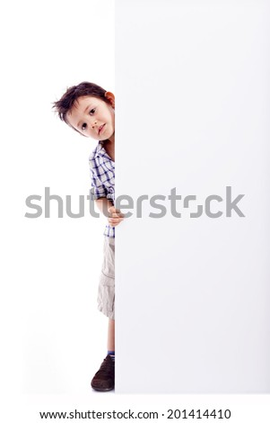 Little boy holding a white banner, isolated on white background - stock photo
