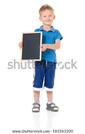 Little boy holding blackboard, isolated on white background - stock photo