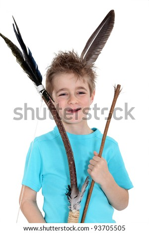 Little boy holding bow and arrow - stock photo