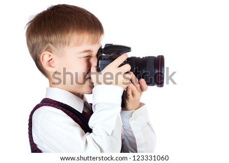 Little Boy holding camera and taking photo. isolated - stock photo