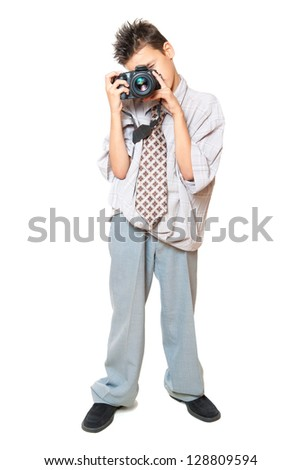 Little Boy holding camera and taking photo isolated on white