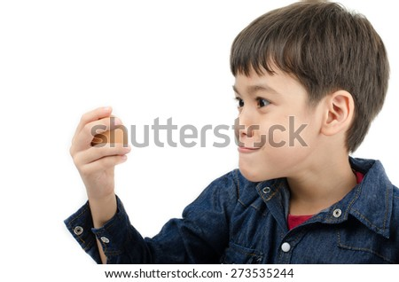 Little boy holding egg in hand healthy on white background