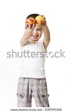 little boy holding fruits - stock photo