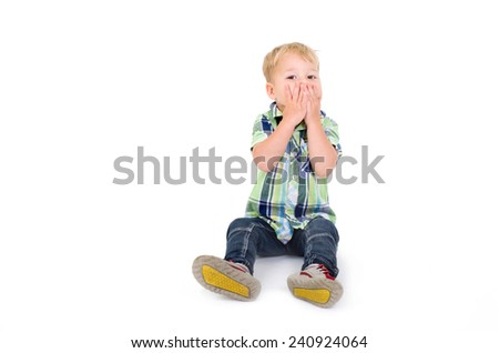 little boy holding his mouth - stock photo