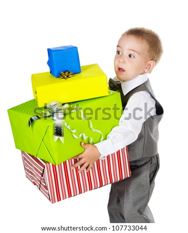 little boy holding many gifts in arms. isolated on white background - stock photo