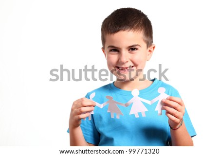 little boy holding paper people - isolated on white - stock photo