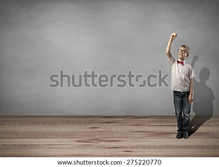 little boy holding pen and writing something - stock photo