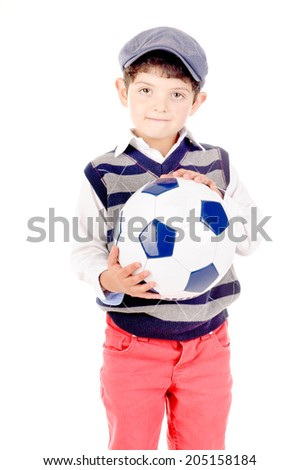 little boy holding soccer ball isolated in white