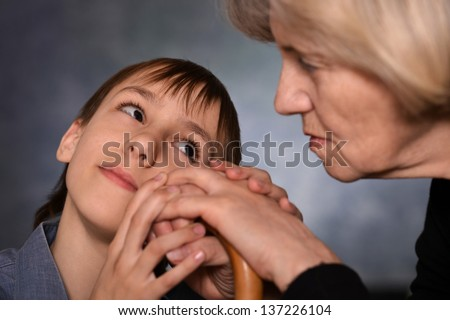 little boy holding the hands his grandmother